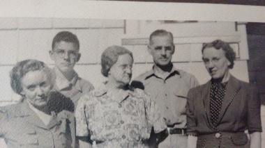family shot, dad back left, Orah center, Lalla at right